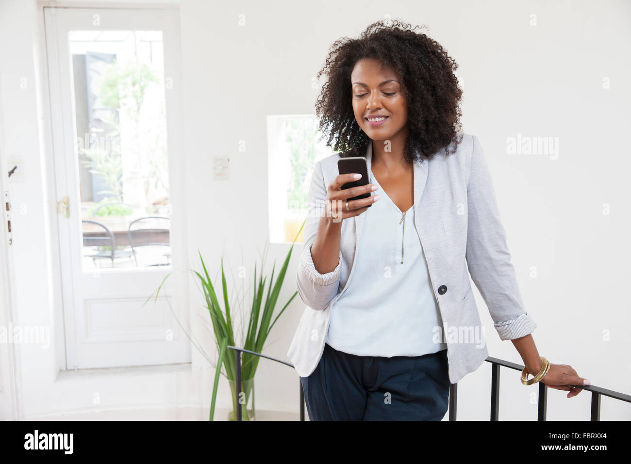 Woman using smartphone - Stock Image