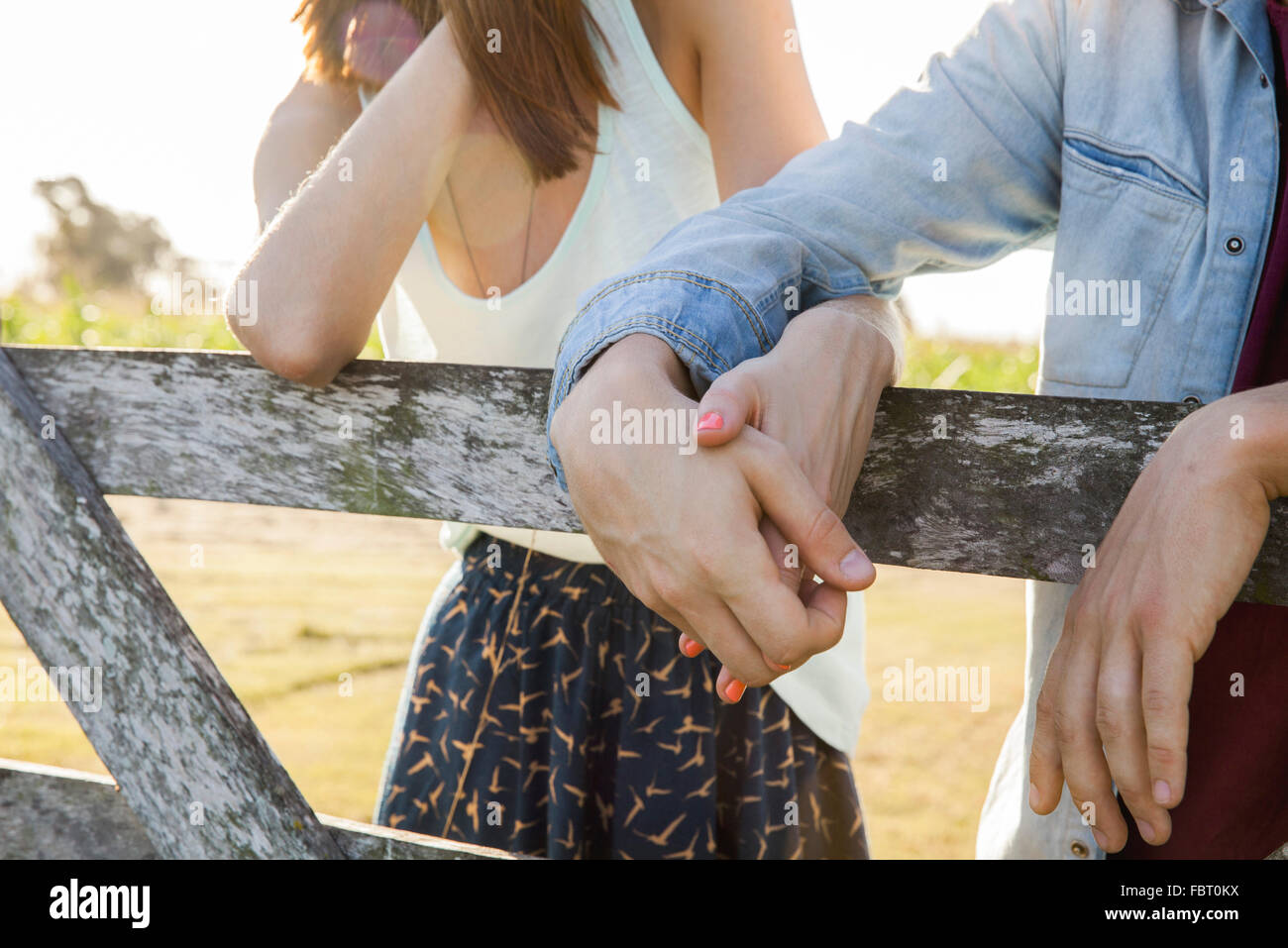 Young couple holding hands, close-up - Stock Image