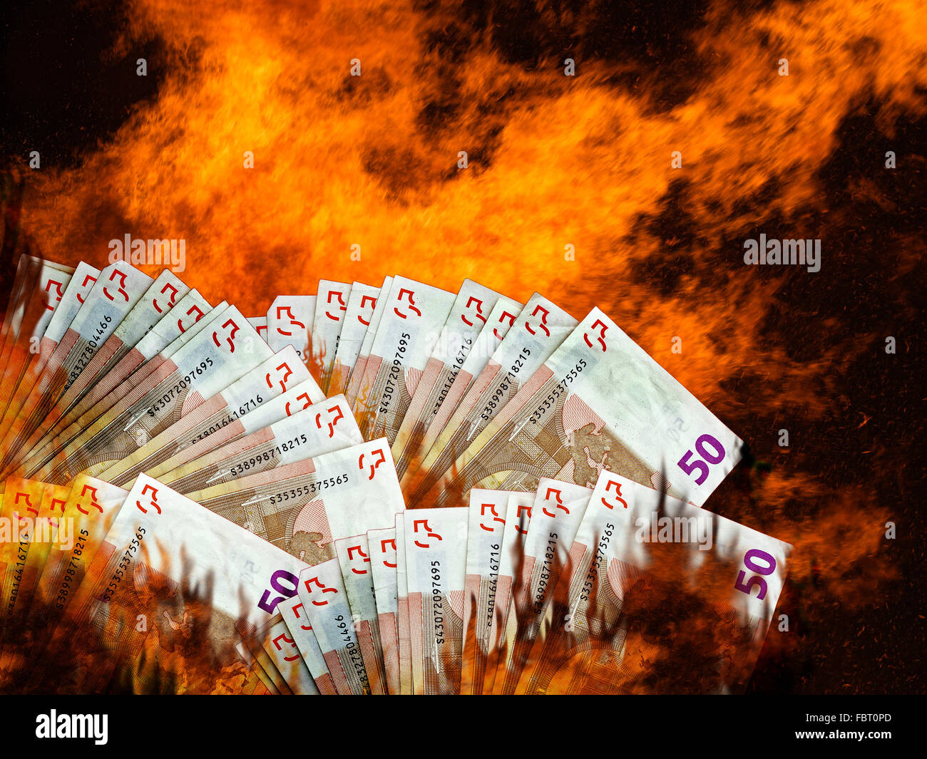 Euro currency or money markets on fire or in flames. Stock market, EU financial crisis etc. - Stock Image