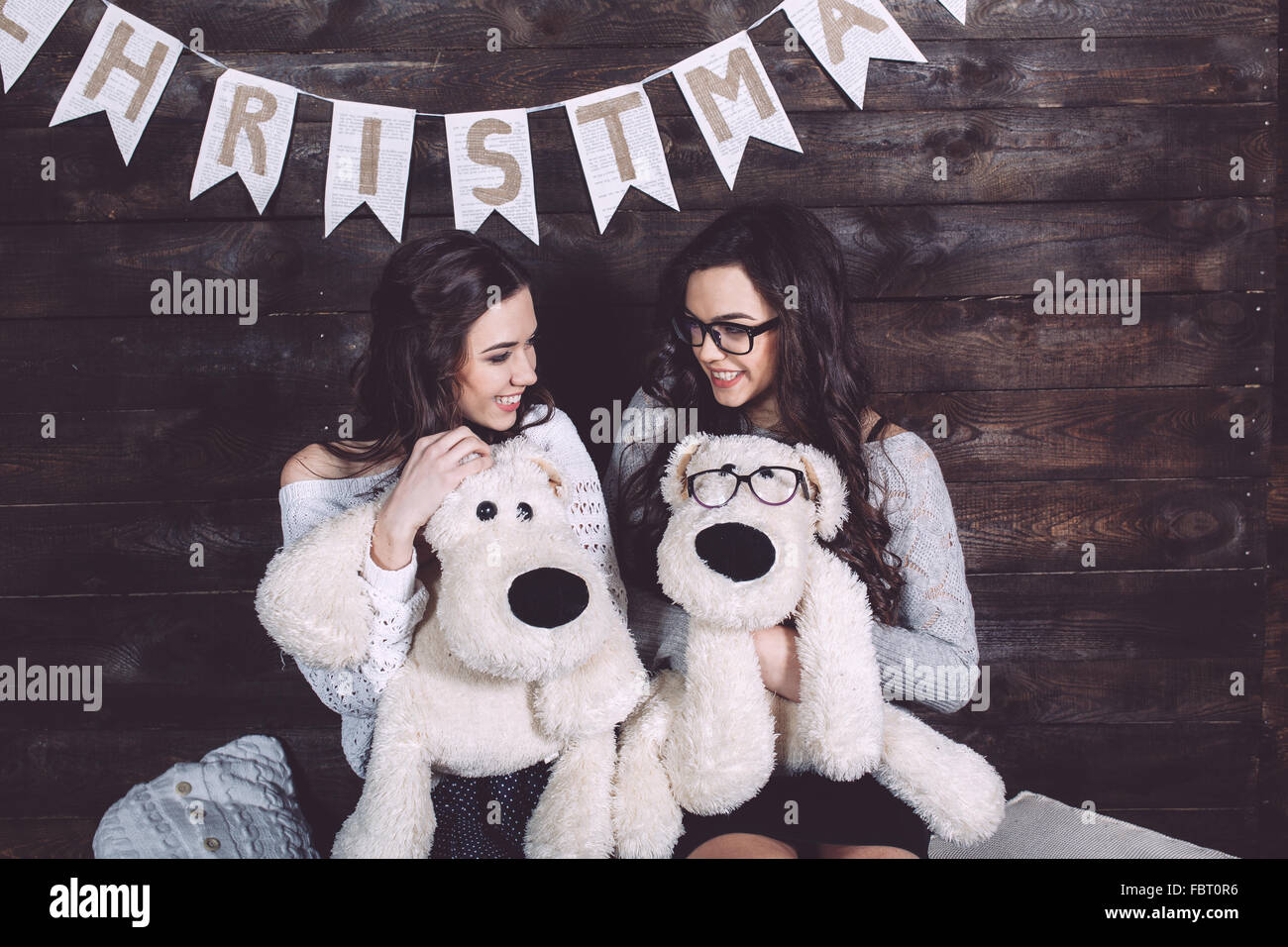 Two charming girls playing - Stock Image