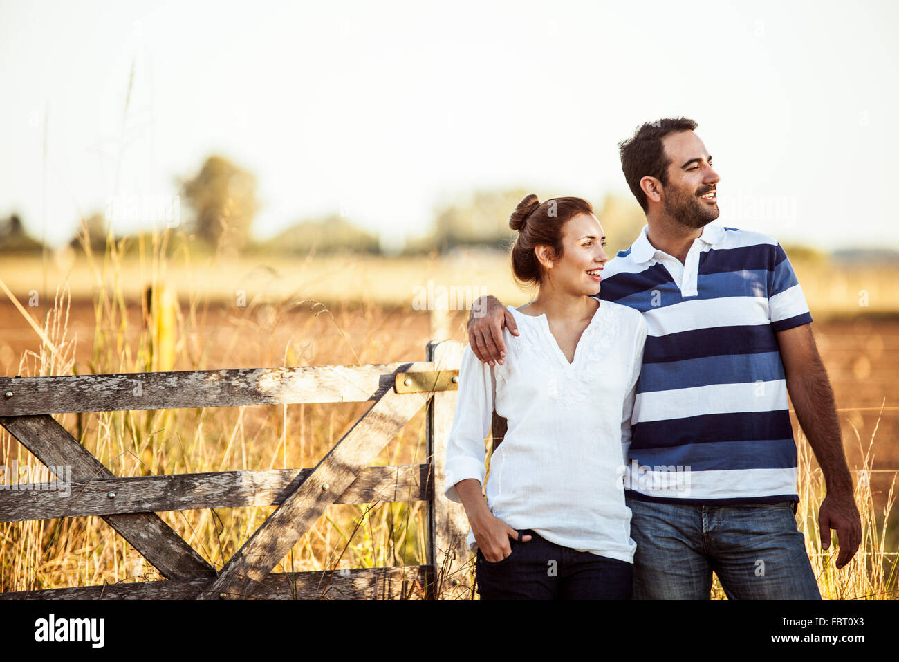Couple admiring view of countryside Stock Photo