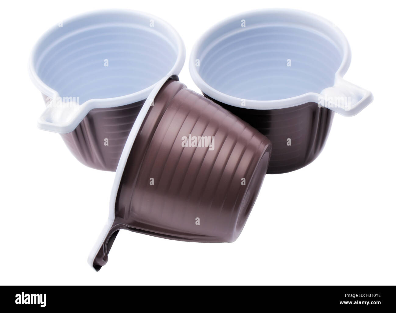 Three brown plastic disposable cups - Stock Image