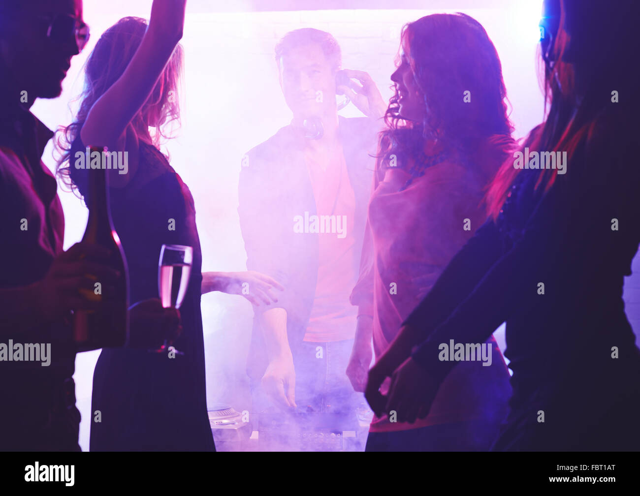 Young energetic friends dancing at party - Stock Image