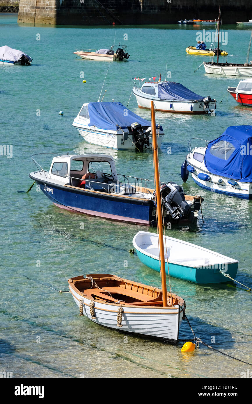 Small fishing boats and pleasure craft in St Ives Harbor Stock Photo