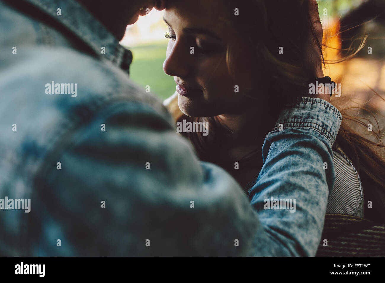 young couple outdoors - Stock Image