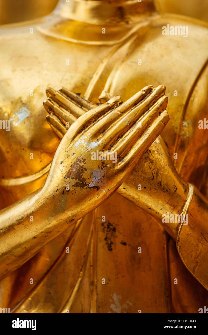 Buddha statue hands close up - Stock Image