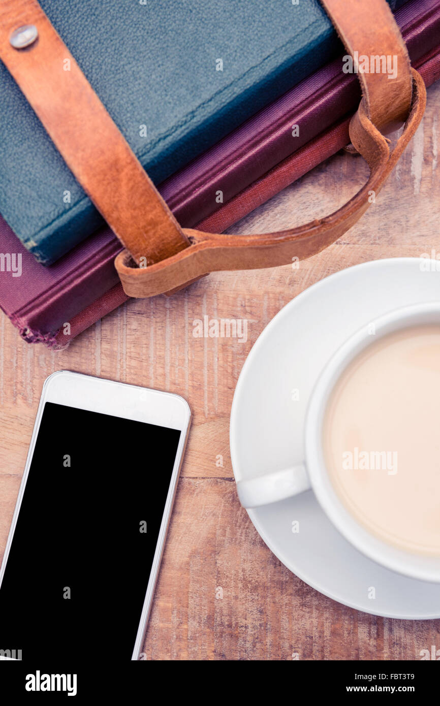 Smartphone with coffee and diaries - Stock Image