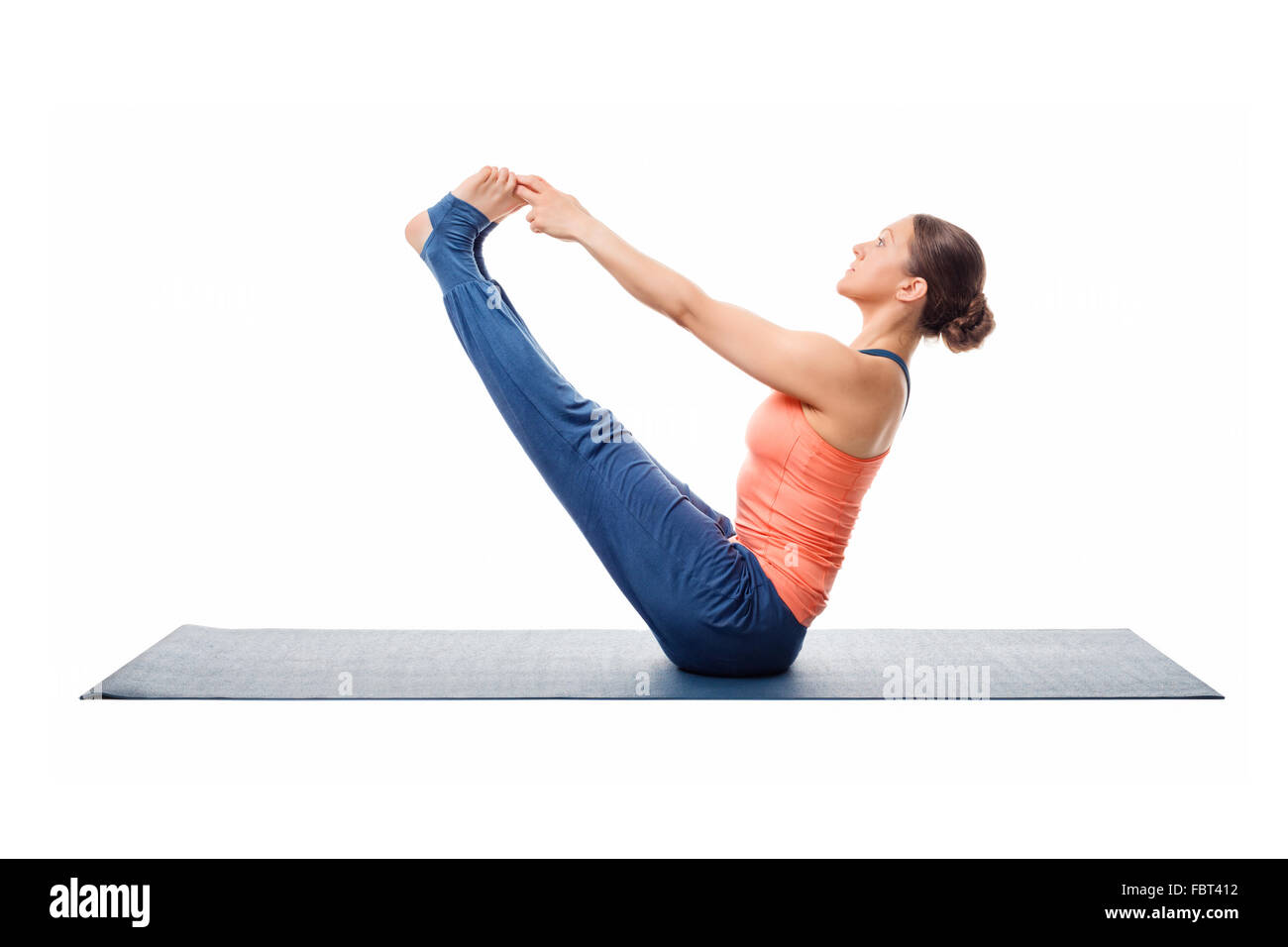 Beautiful sporty fit woman practices yoga asana - Stock Image