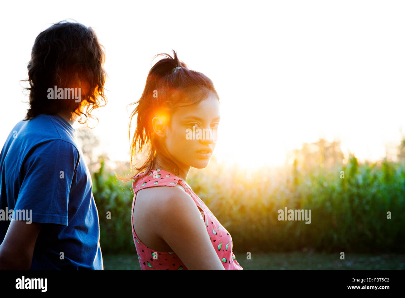 Young couple watching sunset - Stock Image