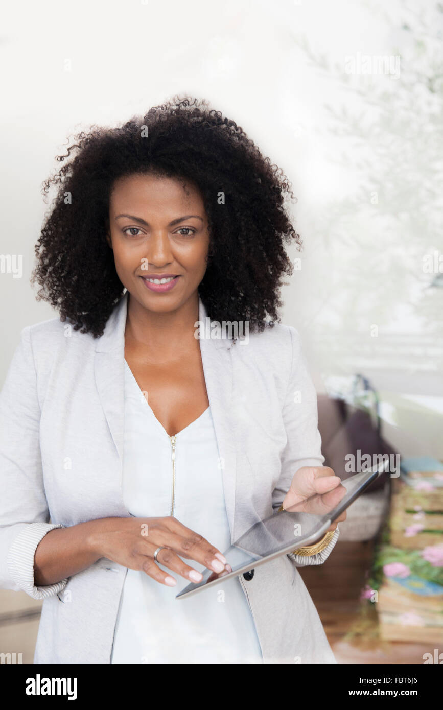 Woman holding digital tablet - Stock Image