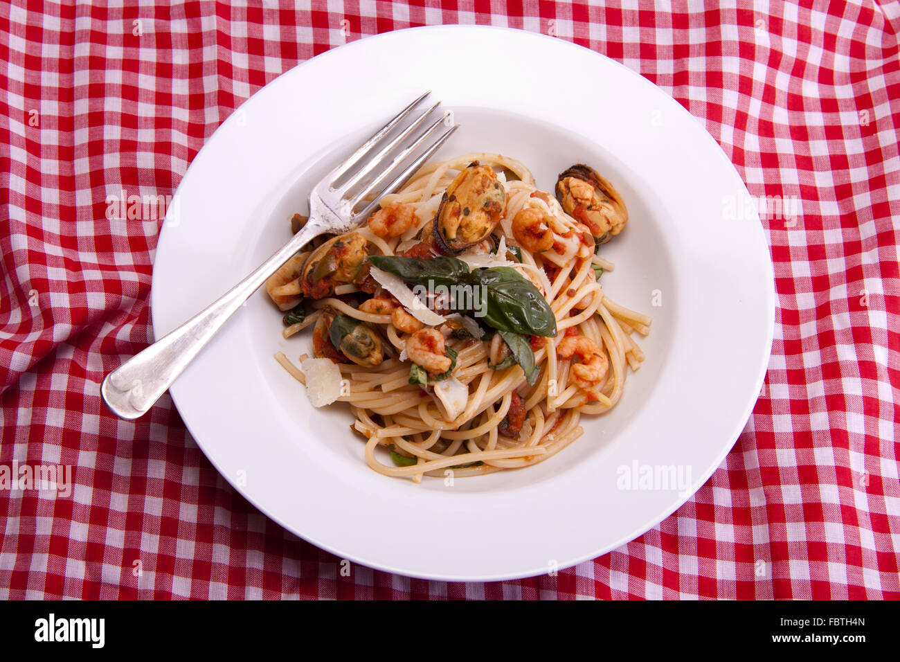 Spaghetti with a tomato and seafood souse. - Stock Image
