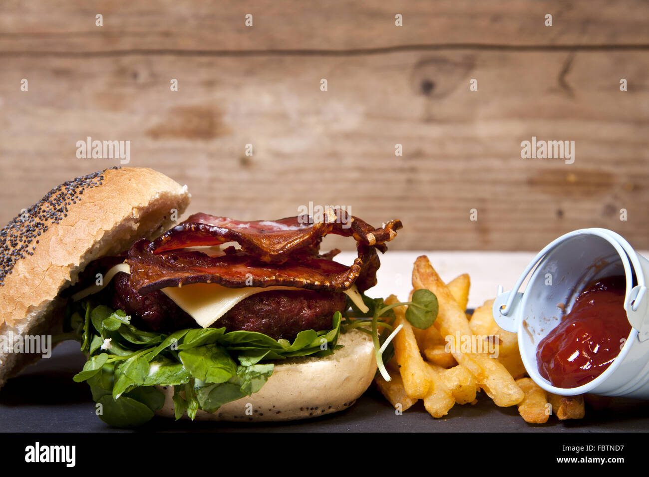 Home made bacon and cheese burger - Stock Image