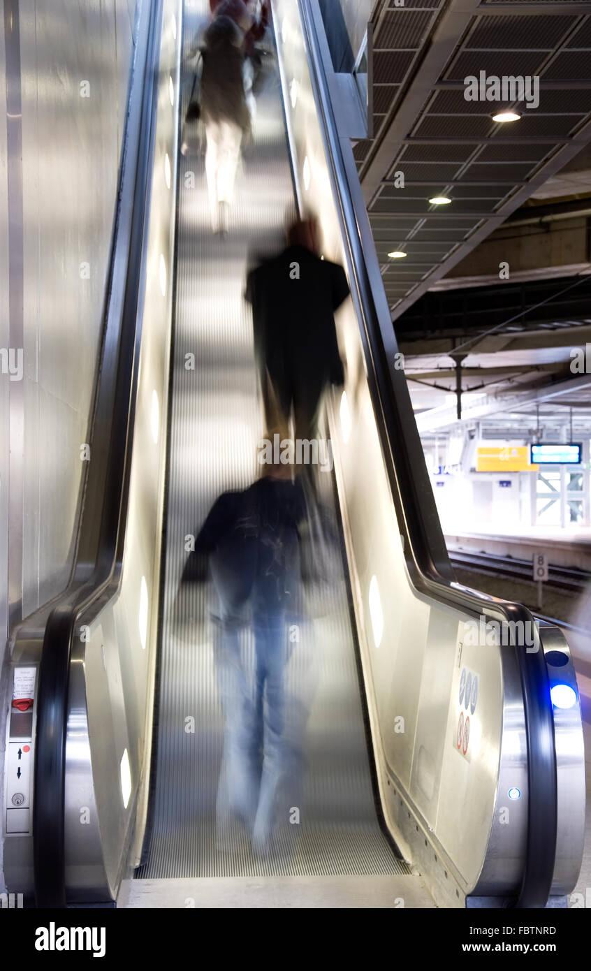 people on escalator - Stock Image