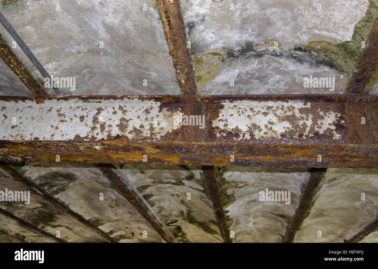 Rust destroys iron carrier Stock Photo