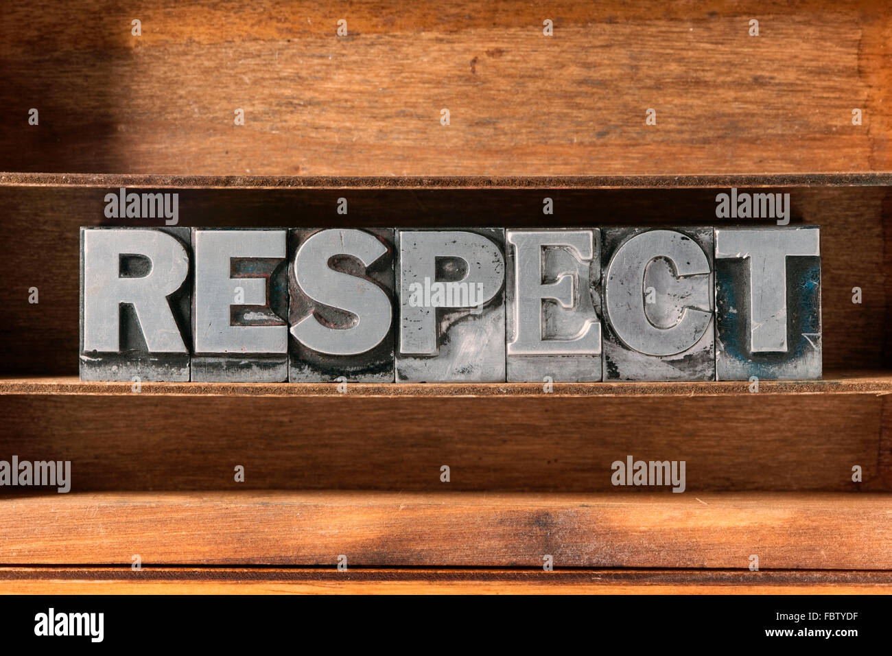 respect word made from metallic letterpress type on wooden tray - Stock Image
