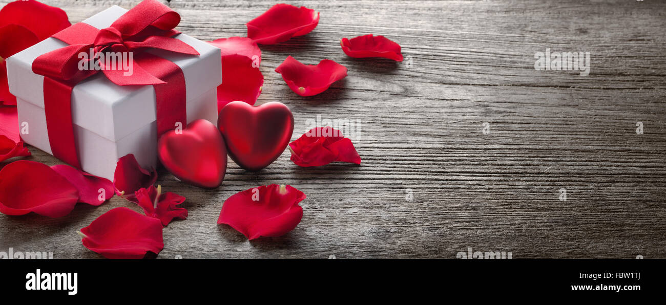 Gift Box And Bunch Of Red Roses On Rustic WoodValentine Background