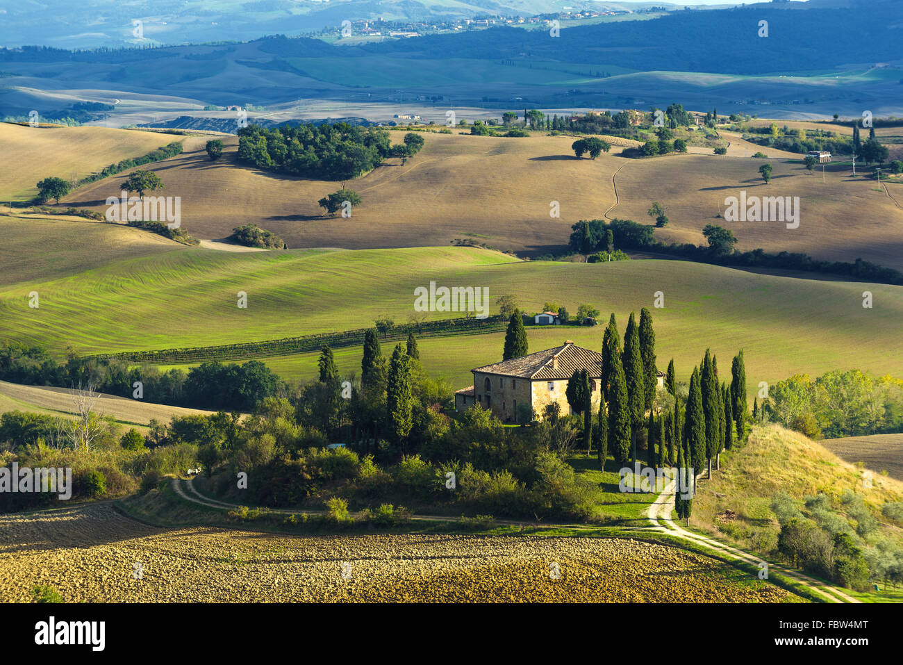 Plowed fields in the picturesque landscape of Italy. Tuscany landscape. - Stock Image