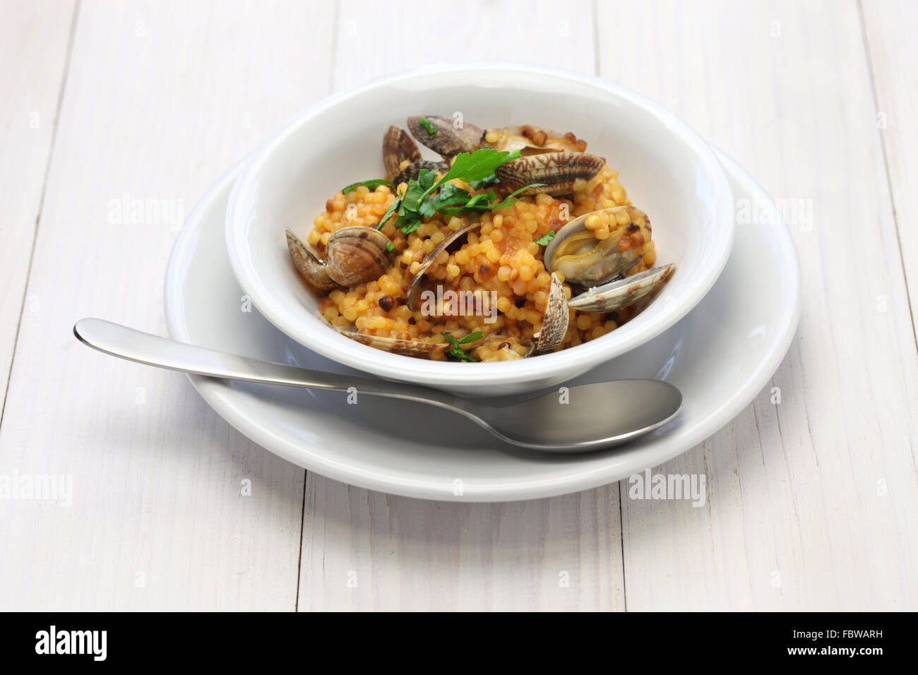 sardinian pasta with clams, italian cuisine, fregula con vongole, fregola con arselle - Stock Image