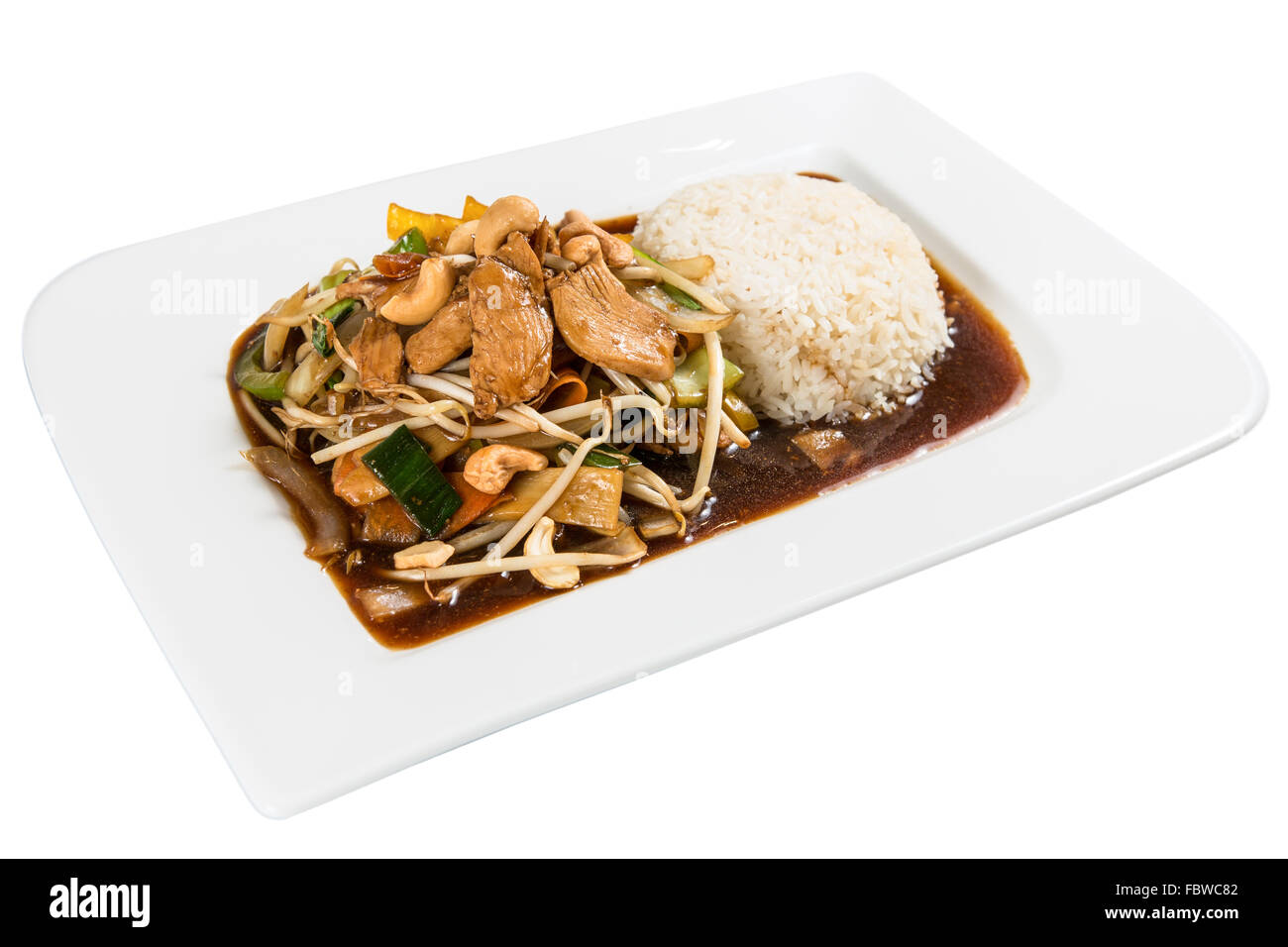 Chinese Asia Food. Pork, bean sprouts with vegetables, cashjew cores  and rice. Background white isolated. - Stock Image