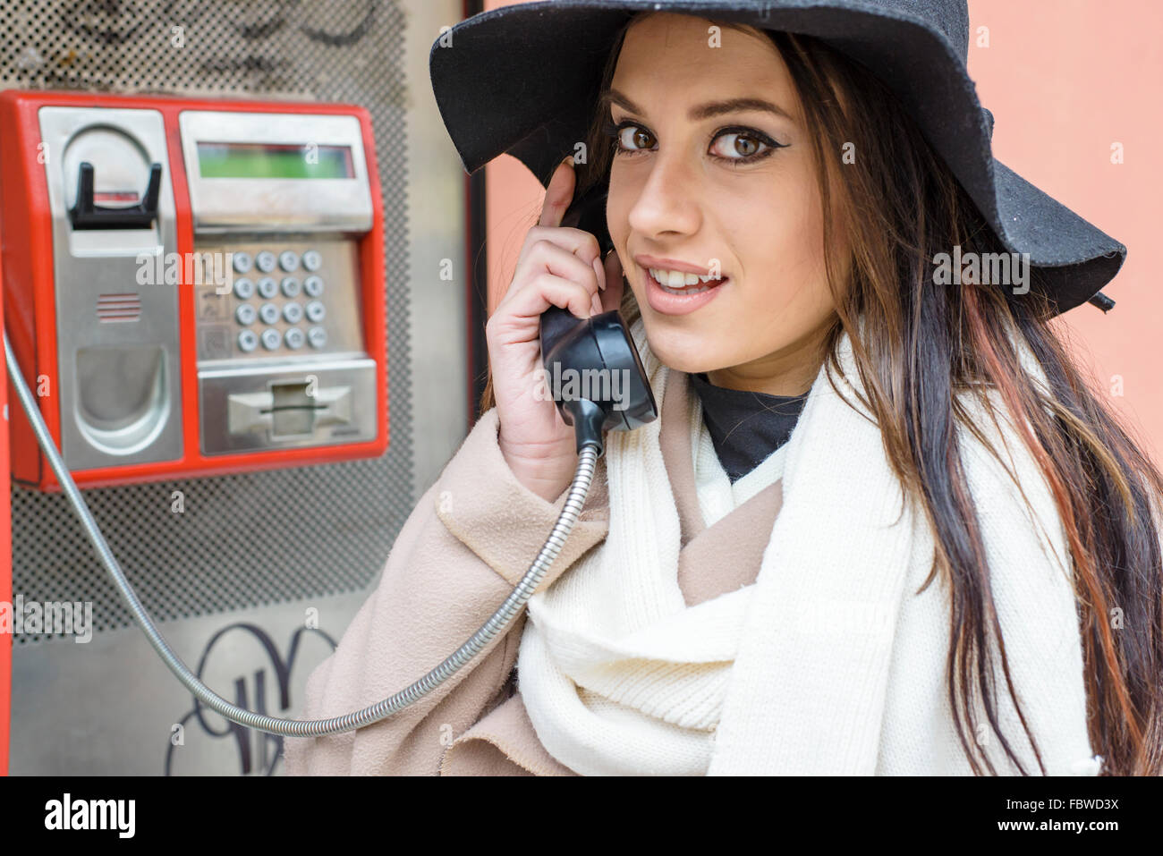 Young woman at the call box - Stock Image
