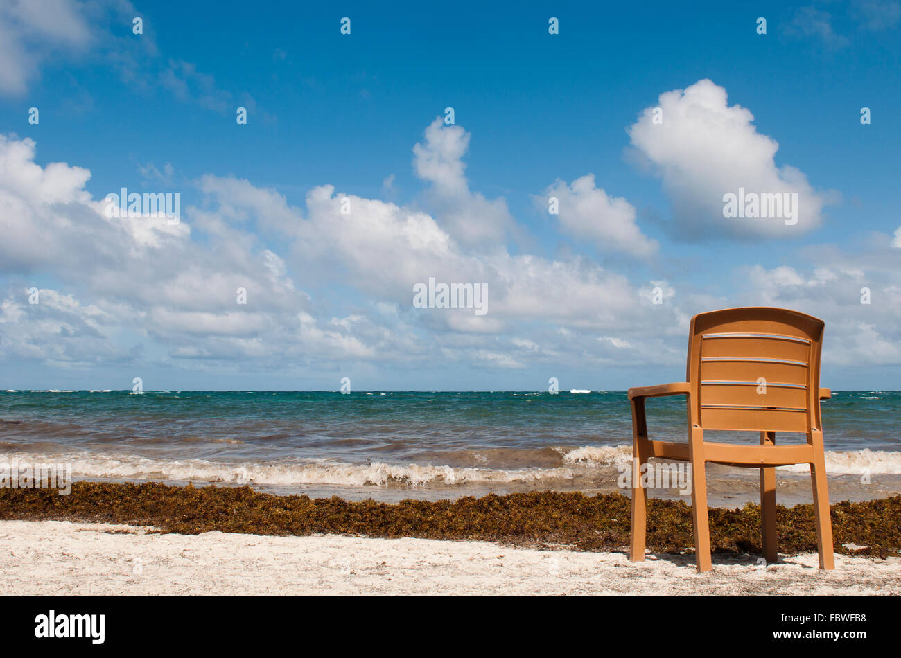 singular chair at the beach in Vieux Fort - Stock Image