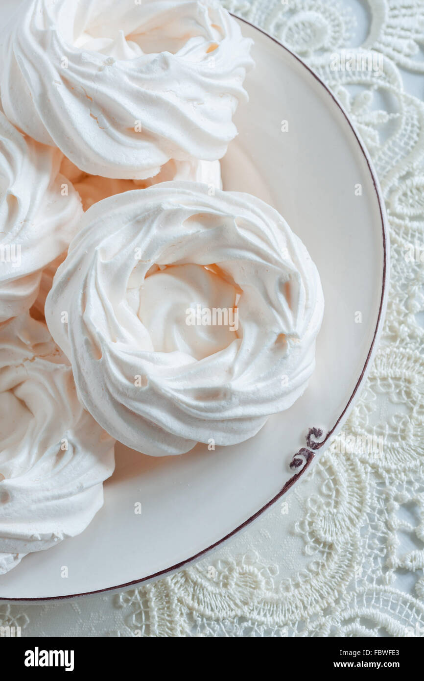 Meringue Nests a light airy confection made from whipped egg whites and sugar - Stock Image