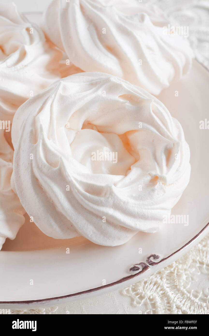 Meringue Nests a light airy confection made from whipped egg whites and sugar Stock Photo