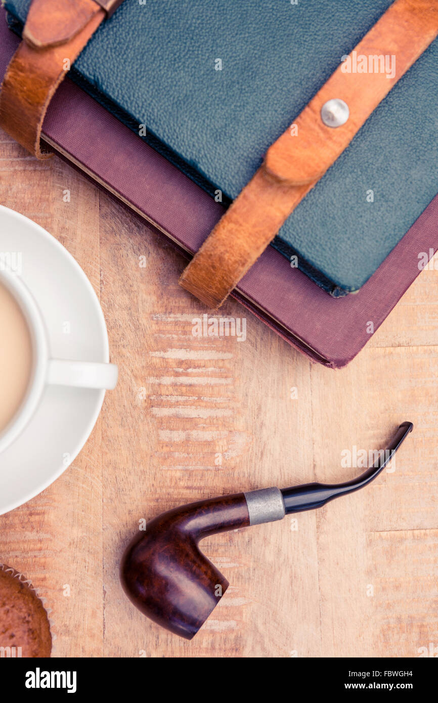 Coffee with diaries and smoking pipe - Stock Image