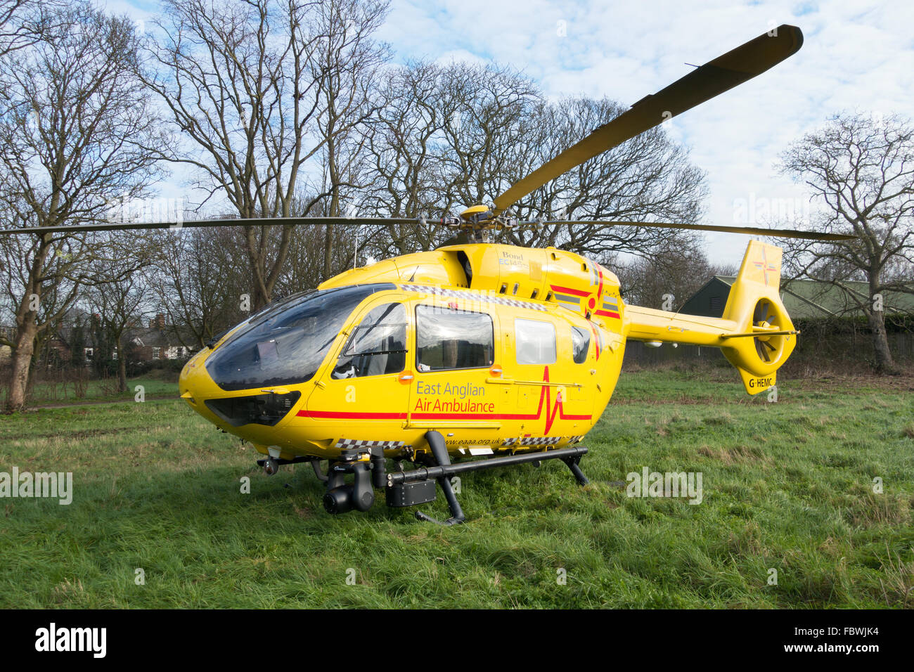 The East Anglian Air Ambulance helicopter on the ground in Newmarket, Suffolk, UK - Stock Image