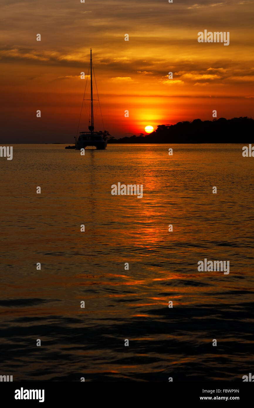 Sunset on a tropical island - Stock Image