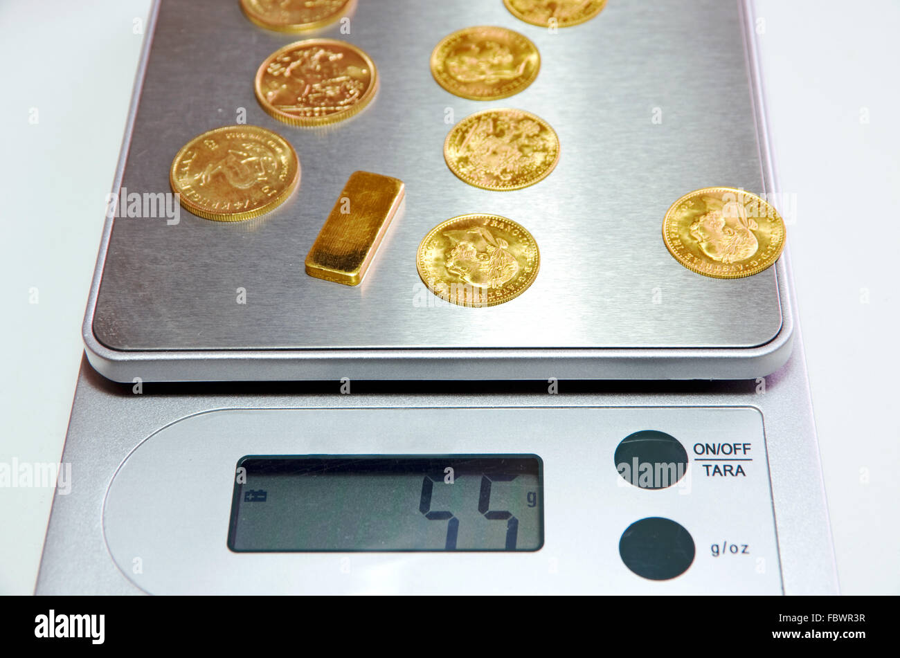 gold bar scales - Stock Image