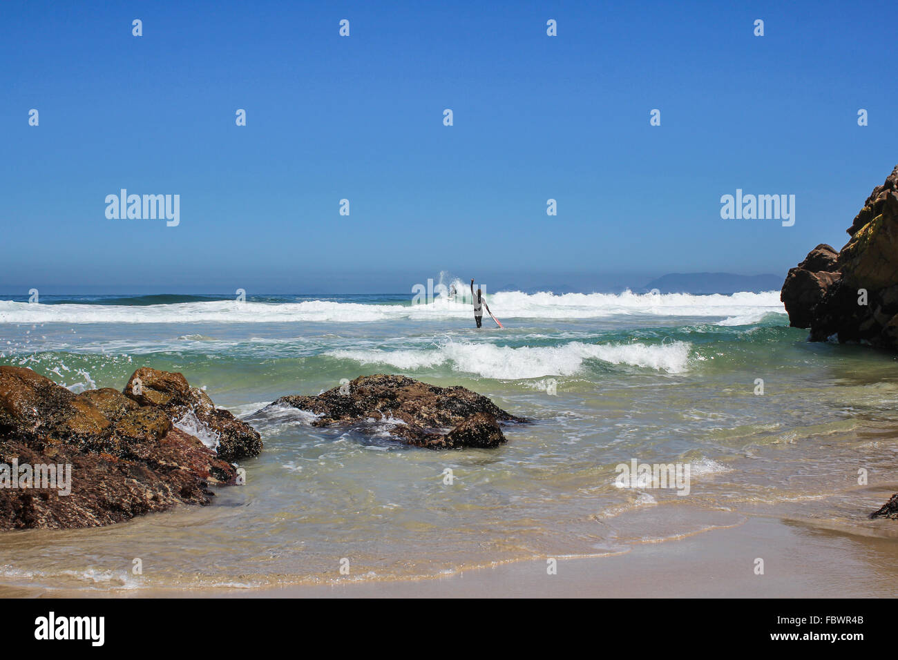 Surfers at a beach in sout africa - Stock Image