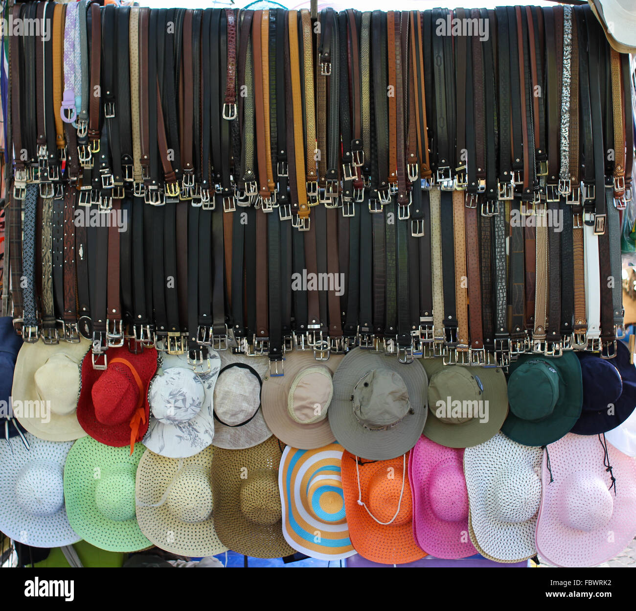 Belts and hats for sale - Stock Image