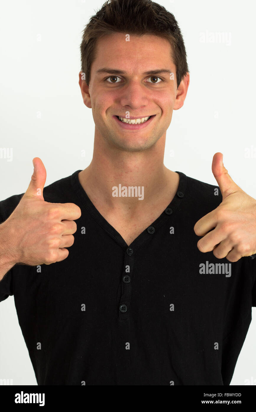 Happy smiling man doing two thumbs up - Stock Image