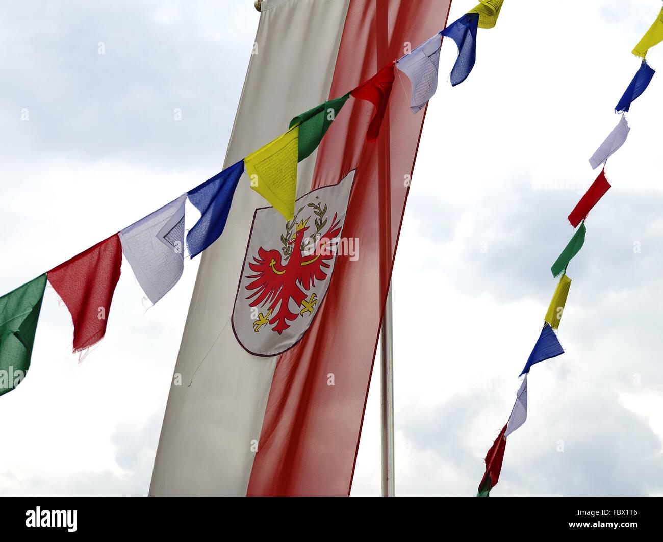 flag of South-Tyrol and  Tibetan prayerflags - Stock Image