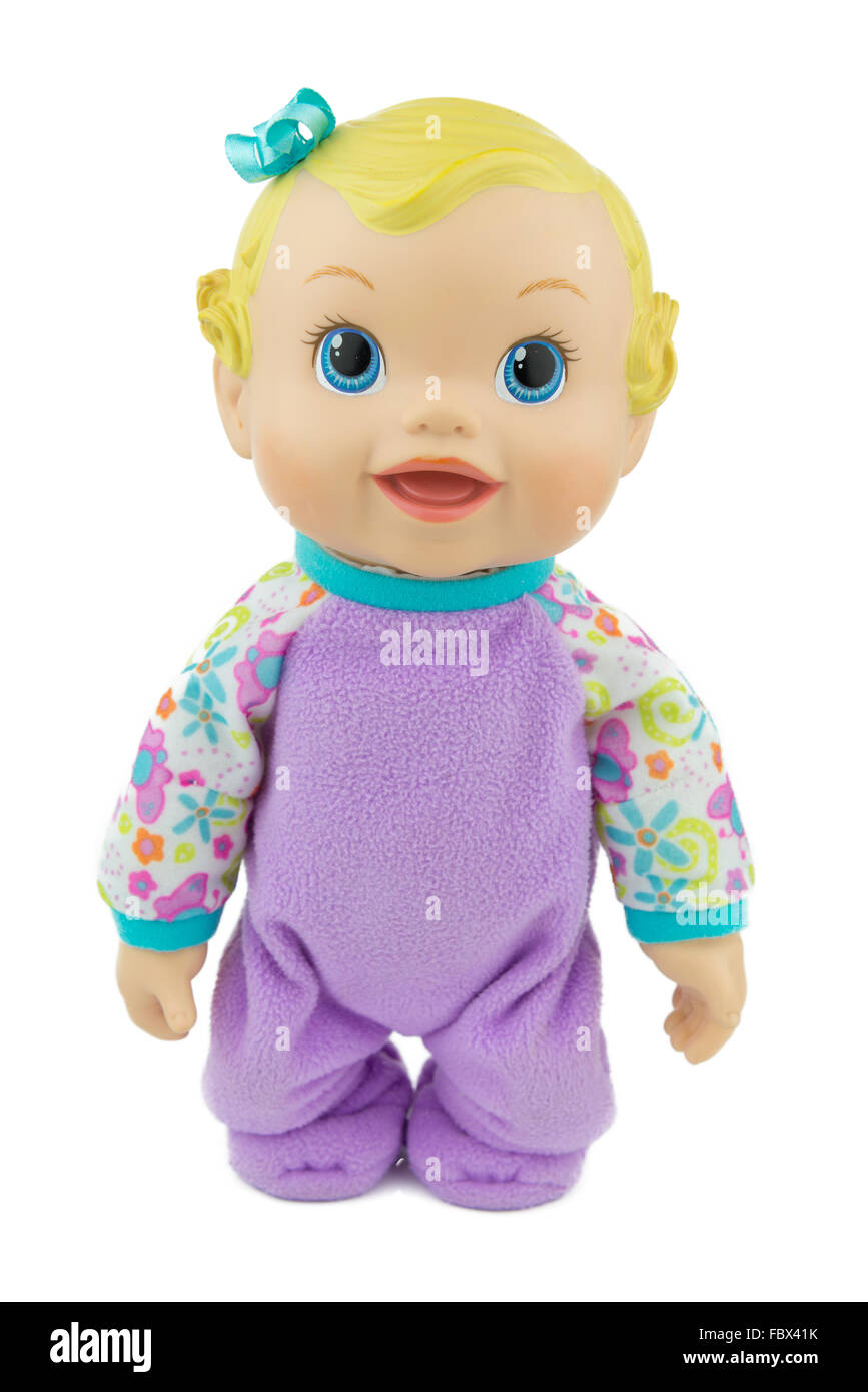 baby girl doll, sitting on isolate background, raising arm - Stock Image
