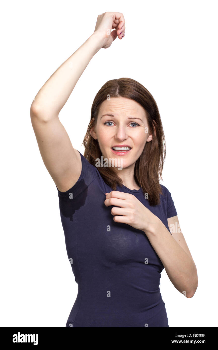 Woman sweating very badly under armpit - Stock Image