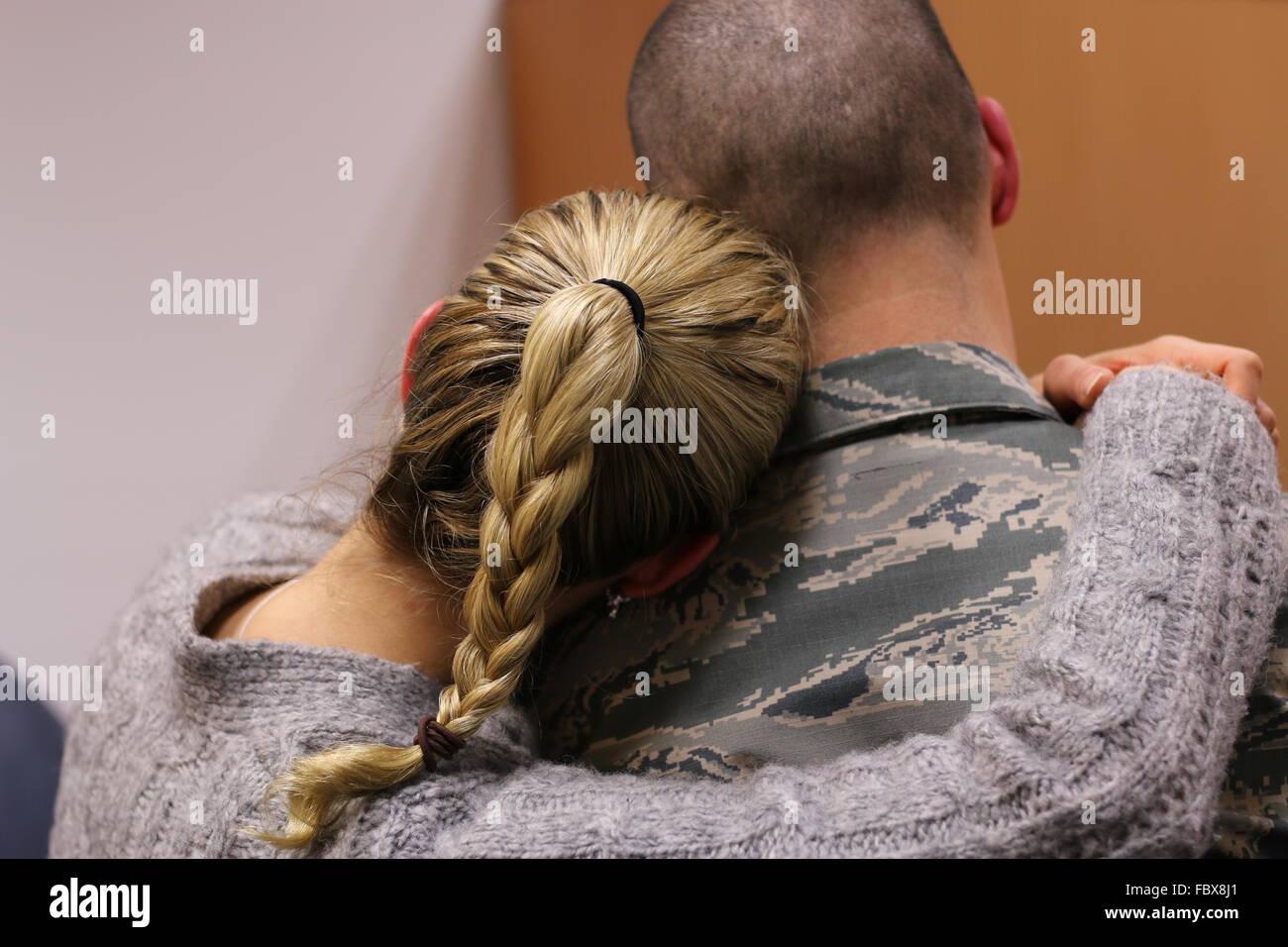 Military couple hugging. - Stock Image