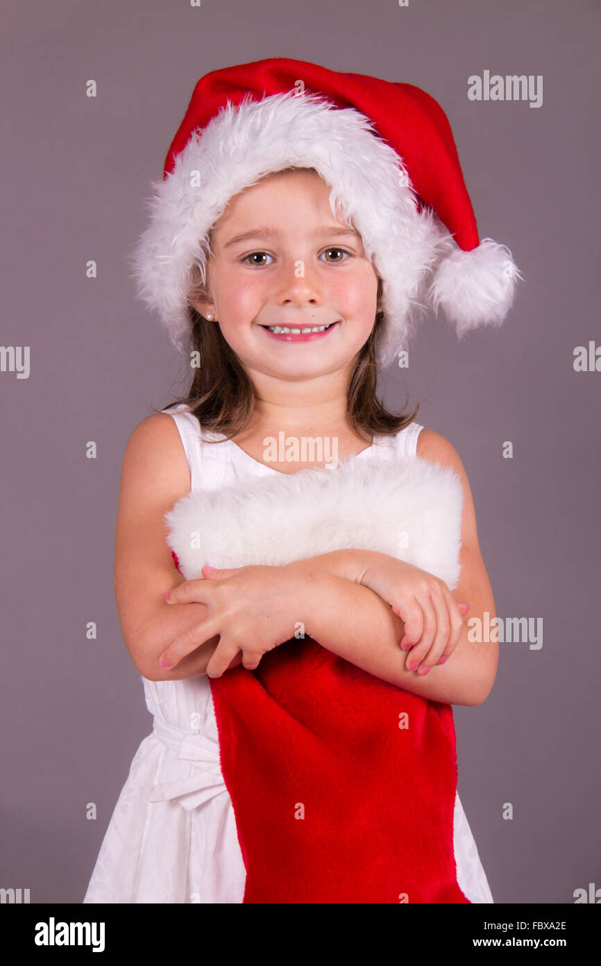 Little girl with her Christmas sock - Stock Image