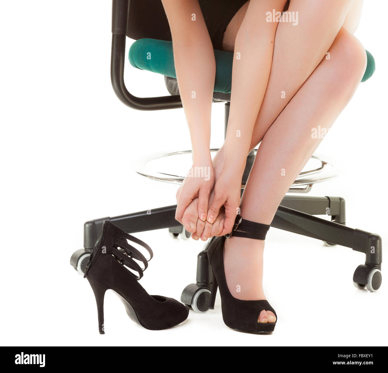 Business Woman On Chair Taking Shoes Off.