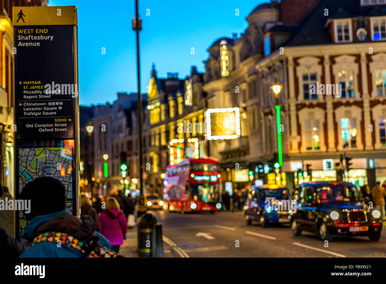Directions board  showing directions from Shaftesbury Avenue, London against a nice colorful background - Stock Image