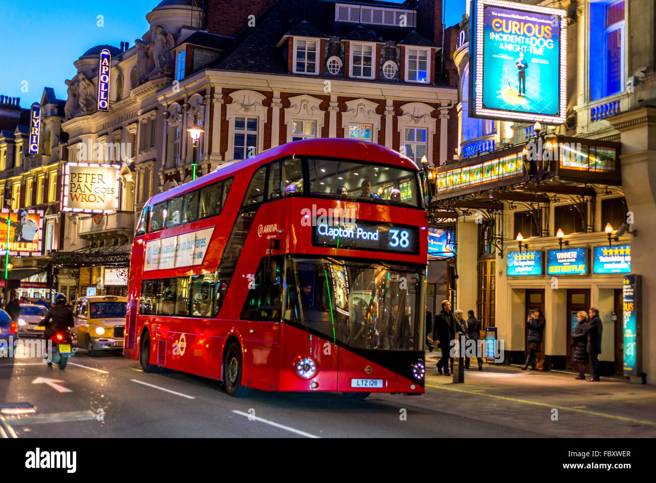 View of Bright Red London bus at twilight, Picadilly Circus, London - Stock Image