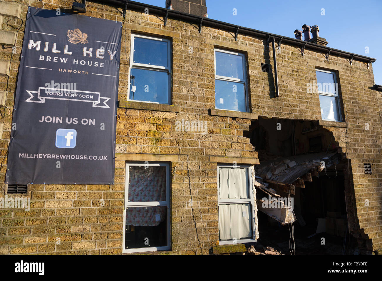 Flooding caused part of a wall of the Mill Hey pub in Haworth, England, to collapse. Stock Photo