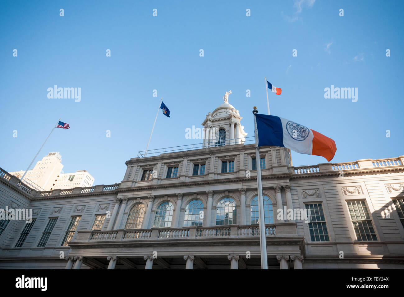 Flags fly in the cold wind in front of New York City Hall on Tuesday, January 19, 2016. (© Richard B. Levine) - Stock Image