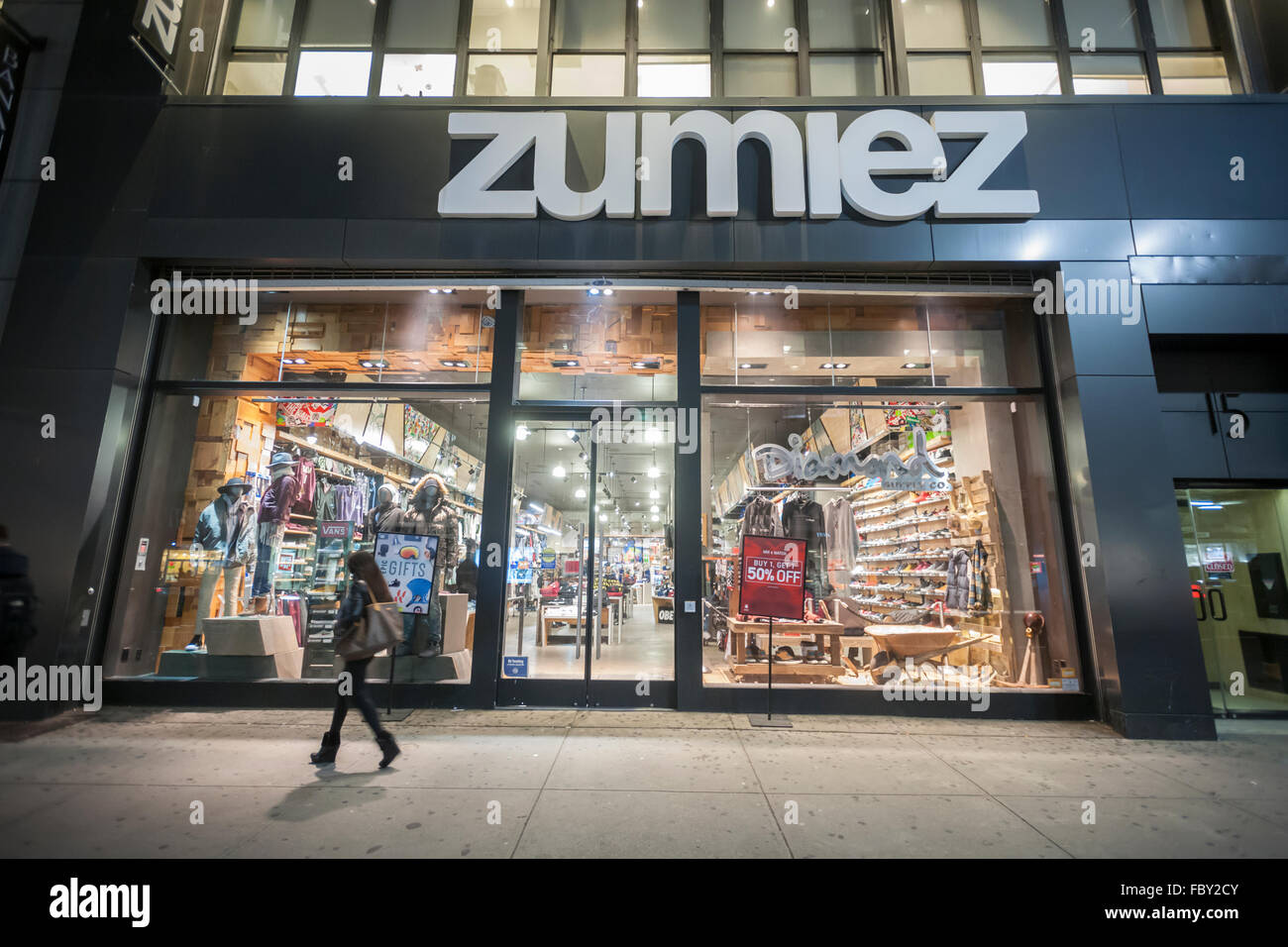Shoppers pass a Zumiez store in Herald Square in New York on Tuesday, January 12, 2016. Zumiez announced that it - Stock Image