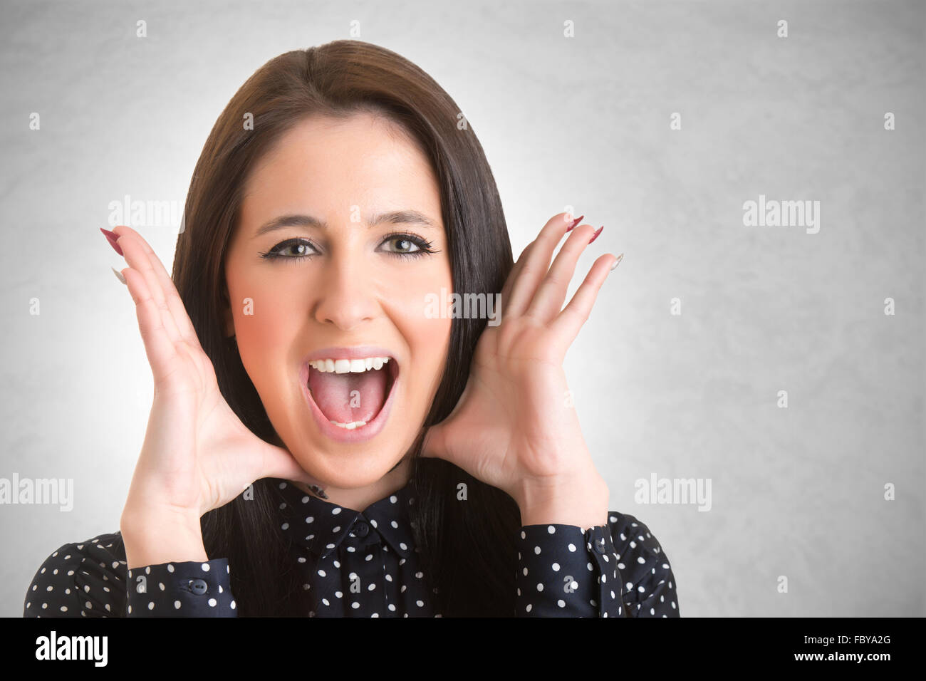 Woman suffering from a nervous breakdown, holding her hands to her head, isolated in white - Stock Image