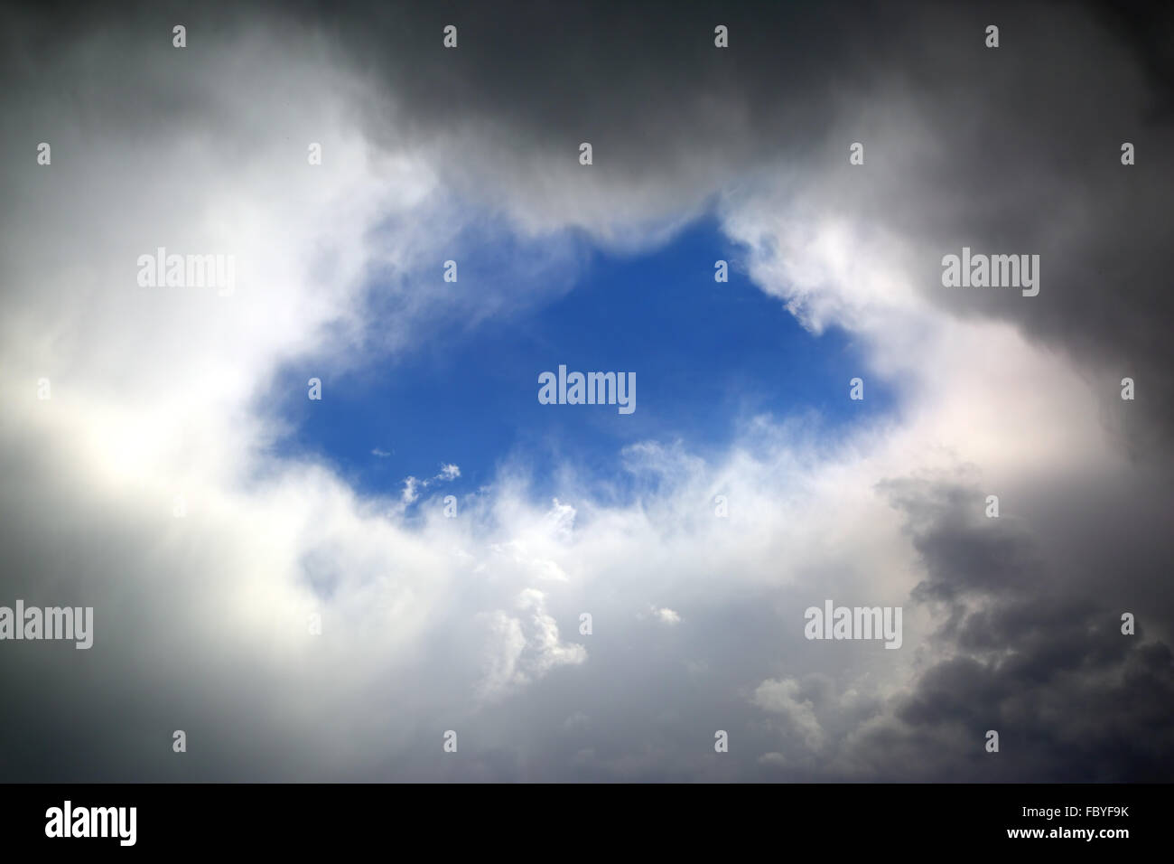 hole in clouds Stock Photo