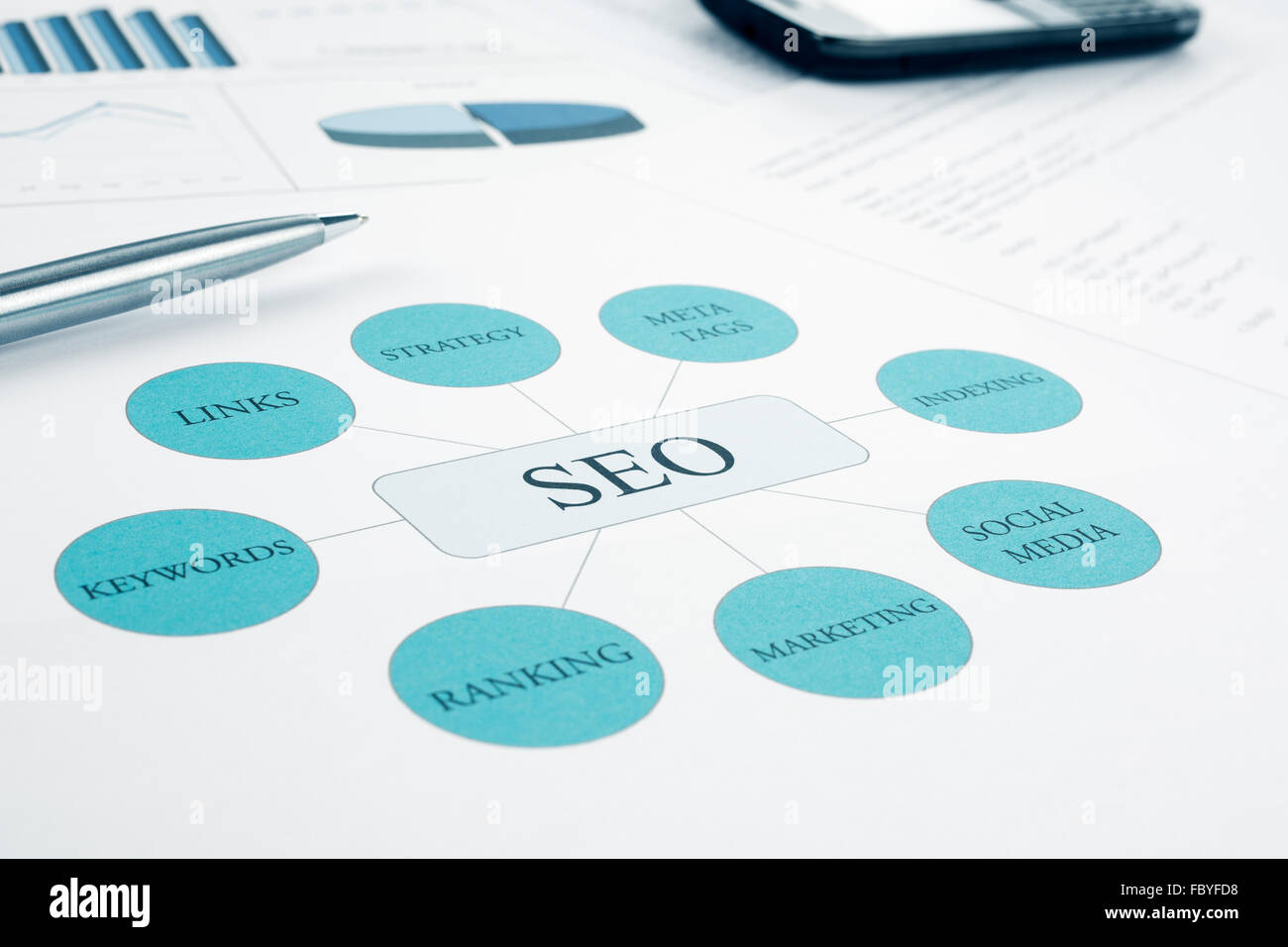 Seo business, search engine optimization concept flow chart. Pen and smartphone on background. Blue Toned - Stock Image
