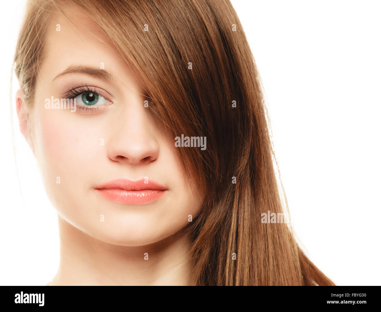 Hairstyle. Portrait of girl with long bang covering eye Stock Photo