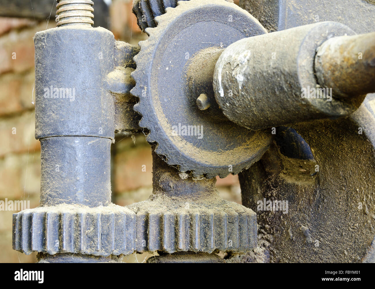 iron gearing mechanism with diverse cogs - Stock Image